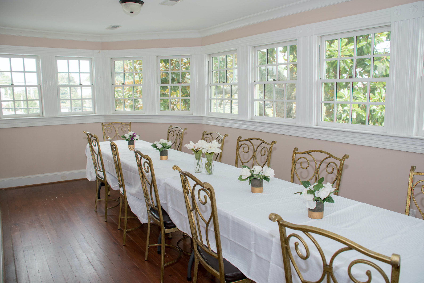 a long table with a white cloth and chairs